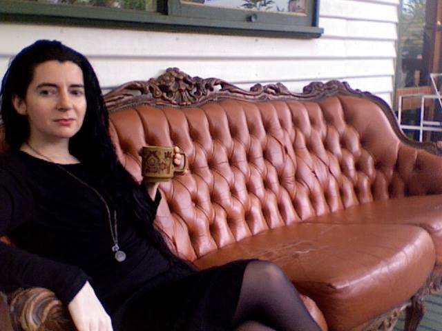Brown couch shabby chic - a rescued visual merchandising window prop re-purposed as fun outdoor furniture.